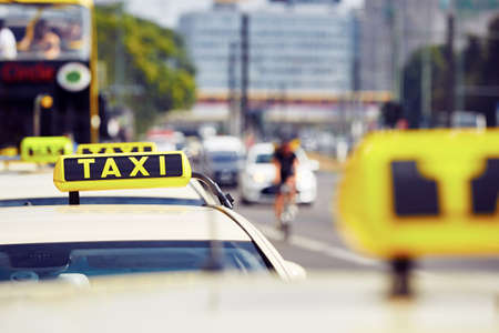 taxi sign: Detail of the taxi car on the street