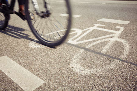 road marking: Cyclist on the cycle lane - blurred motion