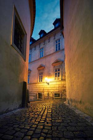 streetlamp: Empty old street at night - Prague, Czech Republic