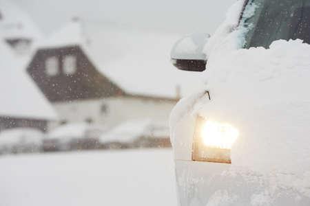 head light: Head light of the car on winter road Stock Photo