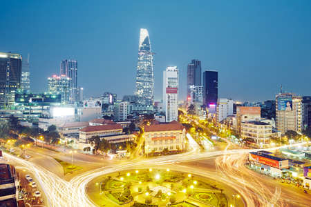 HO CHI MINH CITY, VIETNAM - DEC 16, 2015: Skyline and night traffic around Quach Thi Trang park in Ho Chi Minh City which is the largest city in Vietnam.