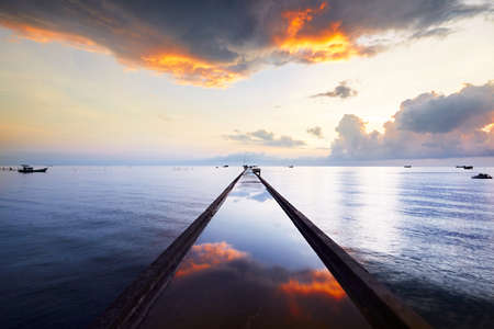 sky reflection: Pier in fishing village - Phu Quoc island, Vietnam