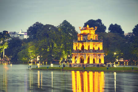 returned: Hoan Kiem Lake (Lake of the Returned Sword) and Turtle Tower in Hanoi - Vietnam Stock Photo