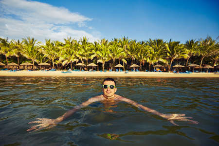 adult vietnam: Young tourist is swimming in the sea - Vietnam