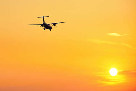 aerospace industry: Silhouette of the airplane at the sunset