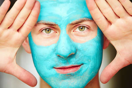 Portrait of young handsome man with facial mask. Banco de Imagens