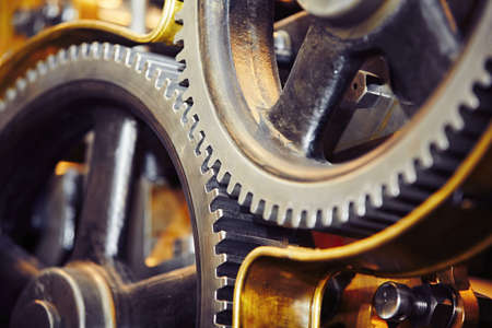 Large cog wheels in the motor - selective focus Stock Photo