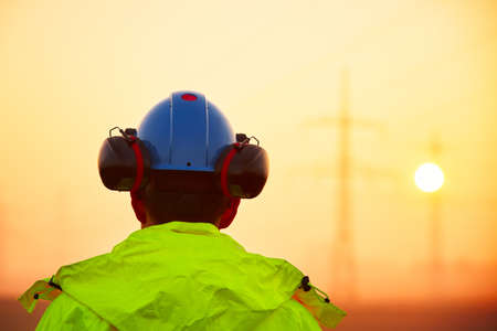 electricity substation: Worker is watching electricity pylons and substation at the sunrise