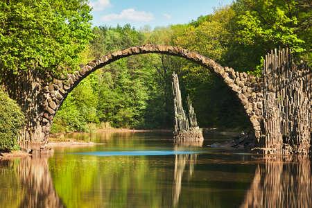 atraction: Amazing place in Germany - Rakotzbrucke also known as Devils Bridge in Kromlau.