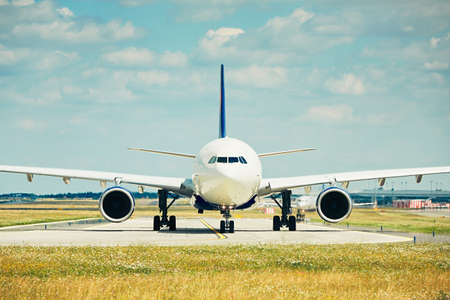 jet plane: Traffic at the airport. Airplanes are taxiing to the runway for take off.  Stock Photo