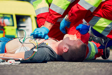 Cardiopulmonary resuscitation. Rescue team (doctor and a paramedic) resuscitating the man on the street. Stock fotó - 60418004