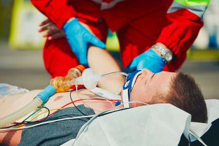 Paramedic preparing the patient after resuscitation for transport to the hospital. Stockfoto