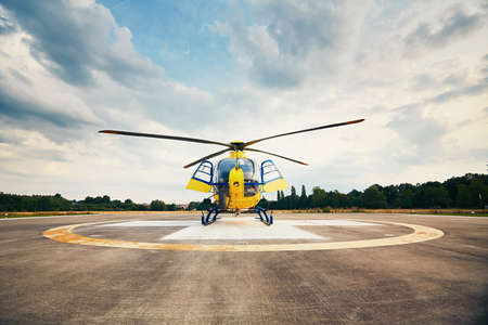 heliport: Air rescue service. Helicopter air ambulance is ready for take off at the heliport.
