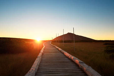 moos: Amazing sunrise in the mounatins. Silhouette of the Snezka - the highest mountain in the Czech Republic.