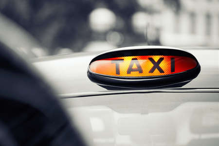 London black taxi cab sign on the street, UK  Stock Photo