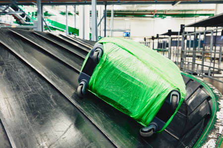 Luggage sorting. Baggage on conveyor belt at the airport.
