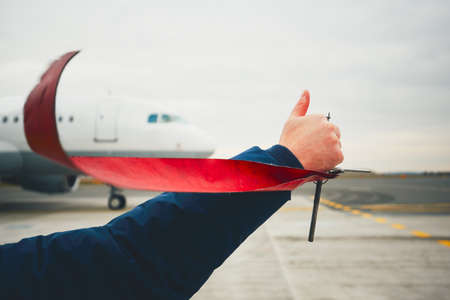 off ramp: Member of ground crew is showing OK sign to pilot before take off. Stock Photo