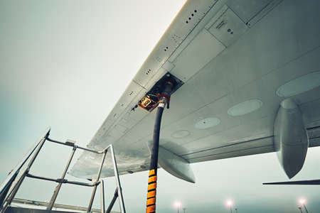 Process of the refueling passenger plane at the airport