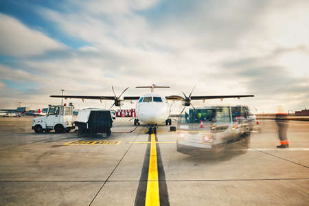 Daily life at the busy airport. Preparation of the turboprop airplane before flight. Imagens