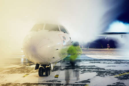 Airport in winter. Deicing of the airplane before flight. Stock Photo