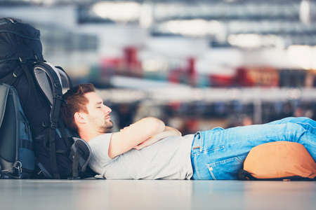 Traveler waiting at the airport departure area for his delay flight. Stockfoto
