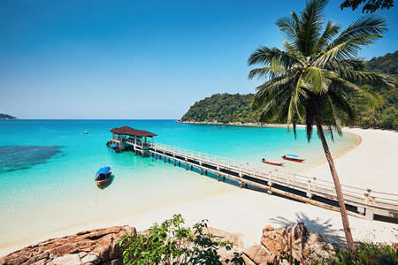 Sunny day on the idyllic beach. Perhentian Islands in Malaysia. Banco de Imagens - 75865441