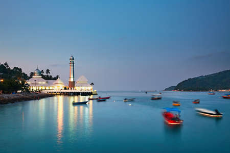 malaysia culture: Perhentian islands during twilight. Illuminated mosque at island Kecil, Malaysia
