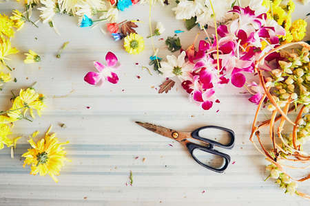 scissors: Scissors on the table in flower shop - making flower garlands for hindu religious ceremony