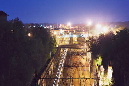 Lights of the express train in railway station at night. Chocen, Czech Republic