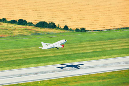 flight mode: Aerial view of the airplane. Take off from the runway in Prague. Stock Photo