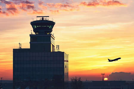 Air Traffic Control Tower at the airport during amazing sunset. Prague, Czech Republic