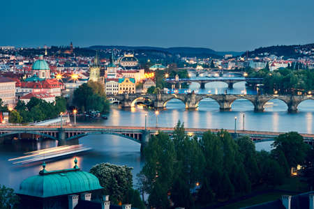 Prague skyline at dusk. Amazing view to Charles Bridge and other bridges cross Vltava river. Stock Photo
