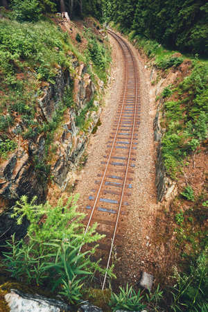 Old railroad track in the middle of the deep forest. Ore Mountains, Czech Republic