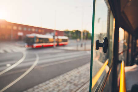 Bus of the public transportation at the sunset. Selective focus on the window of the tram. Banco de Imagens - 81177167