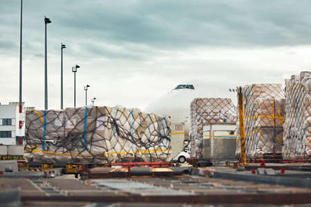 Everyday life at the international airport. Loading of the cargo airplane.