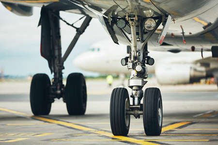 Chassis of the airplane. Plane taxiing from the runway to the gate. Stock Photo
