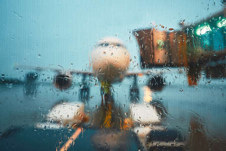 A busy airport in the rain. Push back of the airplane before flight.