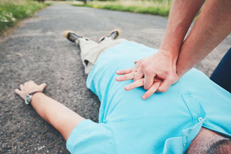 Dramatic resuscitation on the rural road. Themes rescue, help and hope.