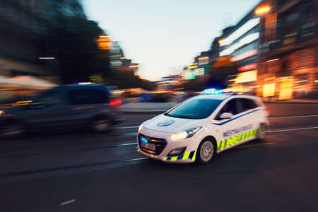 PRAGUE, CZECH REPUBLIC - JUNE 27, 2017: The patrol of Municipal Police of the City of Prague (in blurred motion) respond to an emergency call on June 27, 2017. Editorial