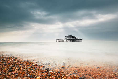 Abandoned (after fire) West pier in Brighton in gloomy day, United Kingdom