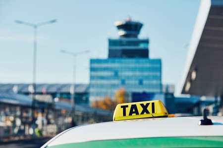 Taxi car on the street in against airport terminal. Prague, Czech Republic Stock Photo
