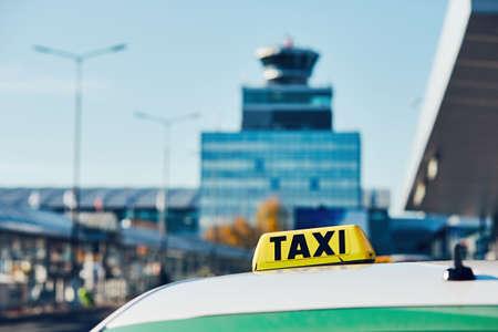 Taxi car on the street in against airport terminal. Prague, Czech Republic Stok Fotoğraf