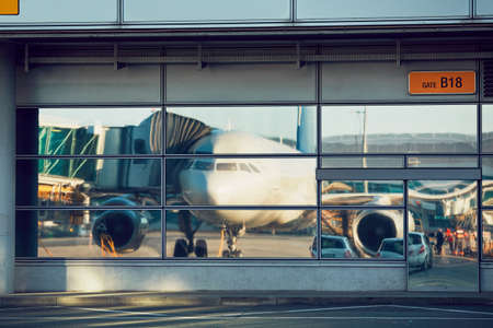 Airport reflections. Preparation of the airplane before flight. Stock Photo
