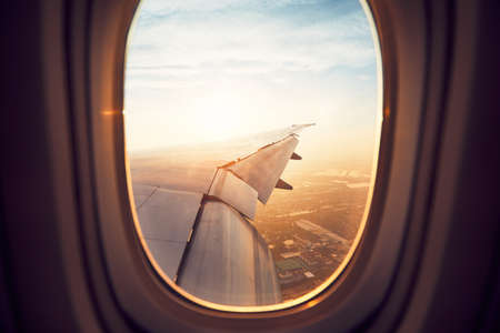 View from the window of the airplane at the sunrise. Landing in Bangkok, Thailand. Banco de Imagens