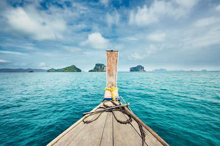 Islands from traditional long tail boat. Sea between Phuket and Krabi in Thailand.