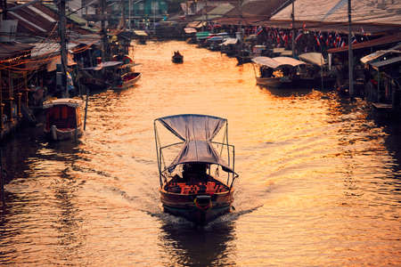 Traditional old floating market Amphawa in Ratchaburi Province near Bangkok, Thailand.