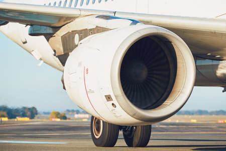 Traffic at the airport. Engine of the airplane on the runway.  Stock Photo