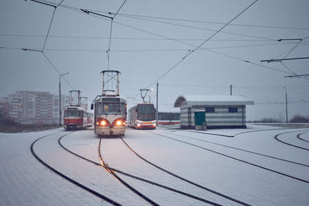 Winter in the city. Trams at the station during heavy snowfall. Prague, Czech Republic