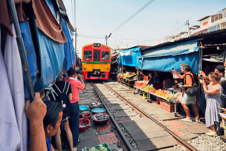 Maeklong, Thailand - November 4, 2017: Railway market on November 4, 2017 near Maeklong station. Train passing through local market is popular tourist attraction close to Bangkok in Thailand.