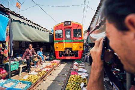 Maeklong, Thailand - November 4, 2017: Railway market on November 4, 2017 near Maeklong station. Train passing through local market is popular tourist attraction close to Bangkok in Thailand.